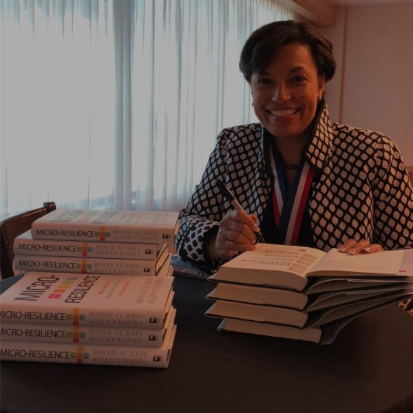 Bonnie St John signing copies of her book Micro-Resilience